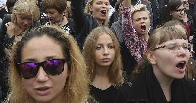 Black-clad Poles protest proposal to completely ban abortion