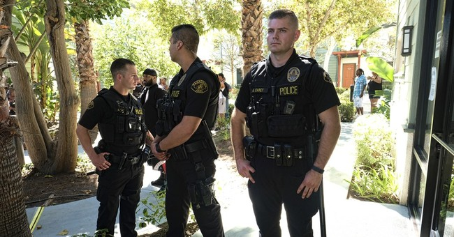 The Latest: March in Pasadena in protest of police death