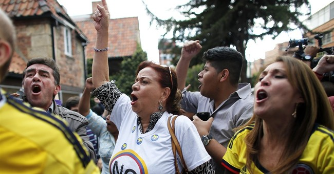 Colombia's leader to push ahead on peace after shock defeat