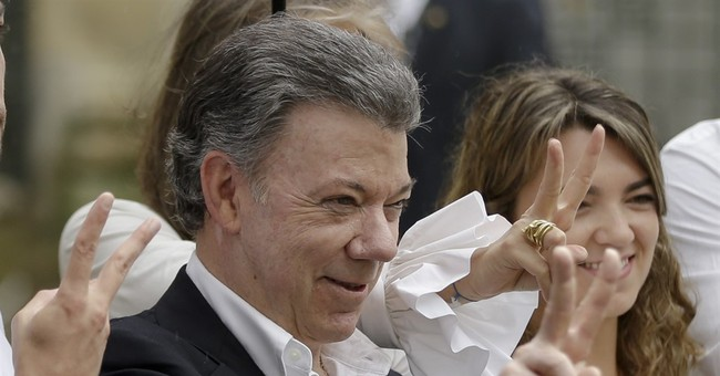 The Latest: Ex-president calls for national pact in Colombia