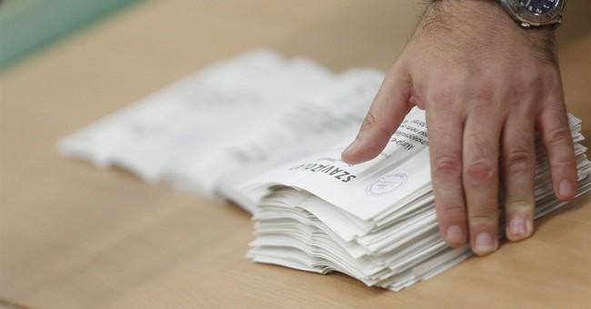 Low turnout invalidates Hungary ballot on EU refugee quotas