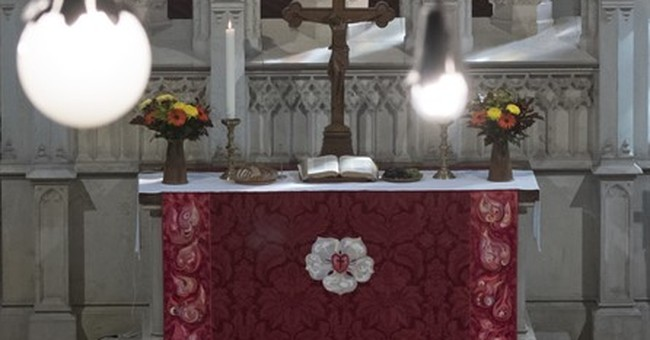 Queen gifts home-made altar hanging to famed Lutheran church