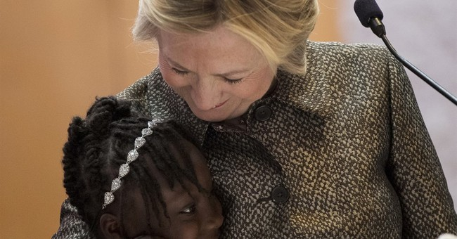 Clinton says wave of shootings show need to protect children