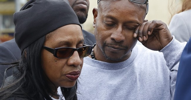 Family of black man shot 14 times by police wants charges