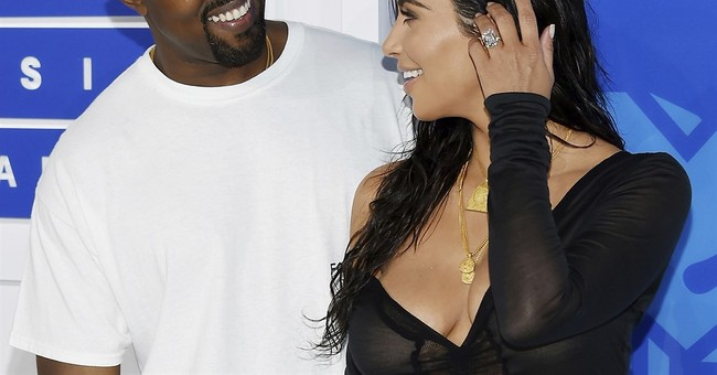 Kanye reschedules tour dates after Kim's Paris robbery