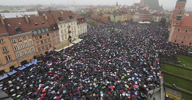 Polish gov't tries to calm mass outrage at abortion proposal