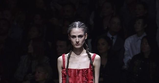 Kardashian robbery casts gray cloud over Paris Fashion Week