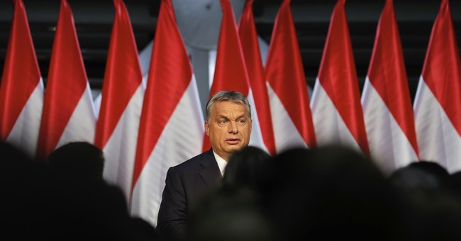 Hungary's Orban seen staying on migrant issue after EU vote