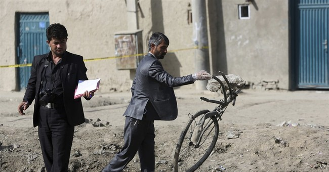 Taliban attack Afghan city that briefly fell a year ago