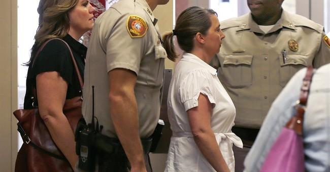 Oklahoma officer's attorneys want handgun kept as evidence