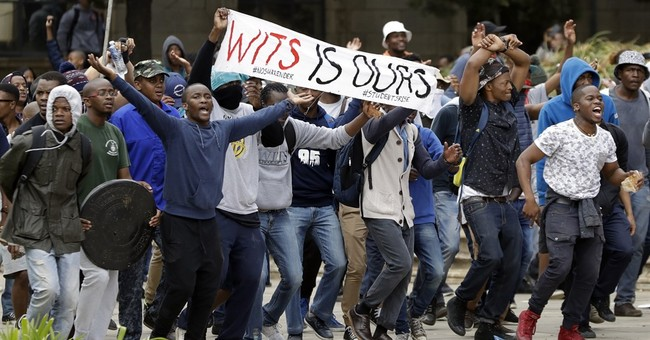 South African police fight students demanding free education