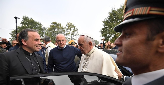 Pope Francis makes surprise visit to quake zone