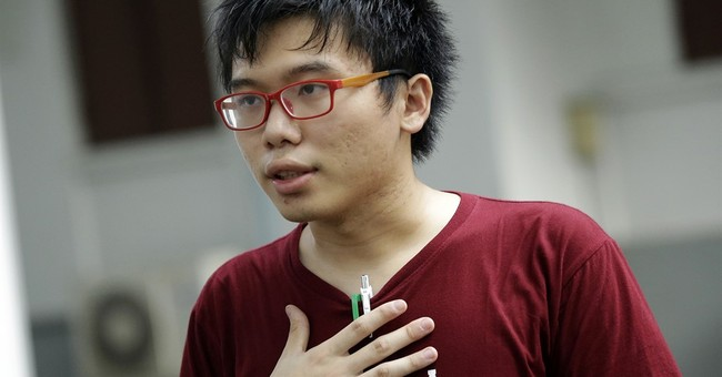 The Latest: Hong Kong activist glad he didn't disappear