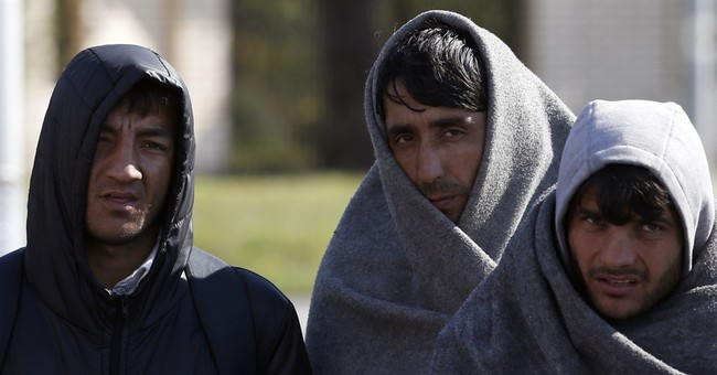 The Latest: Education for refugee children starts in Greece