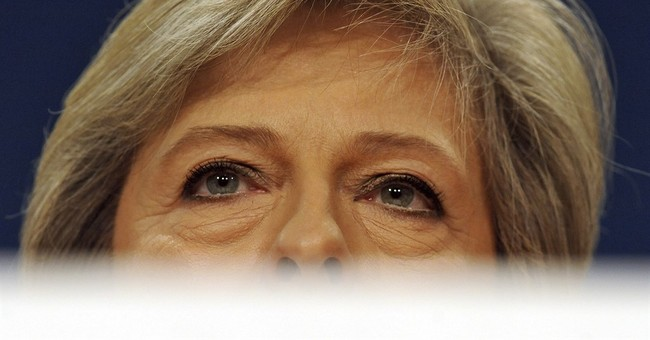 UK leader May vows centrist govt after EU exit 'revolution'