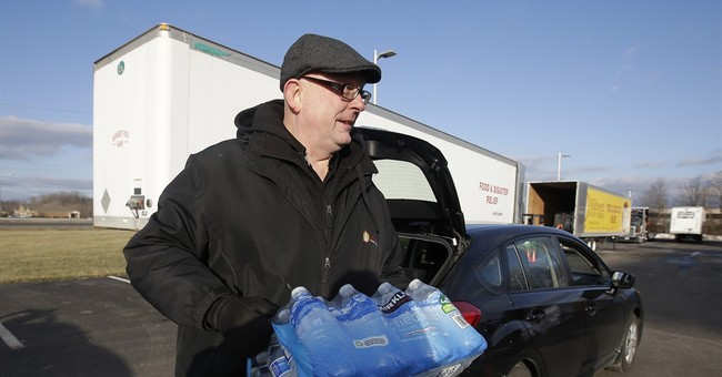 The Latest: State workers have been getting water for a year