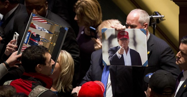 Trump holds his own event as rivals debate