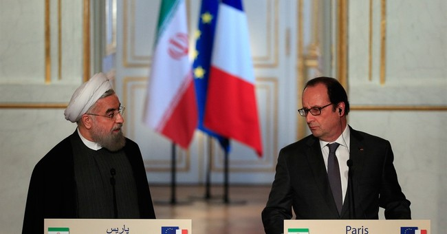 Car-making deals, protests greet Iranian president in Paris