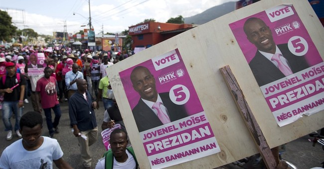 Pro-government marchers in Haiti capital call for elections