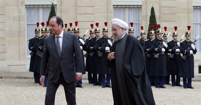 The Latest: East-West contrasts in Iranian leader's visit