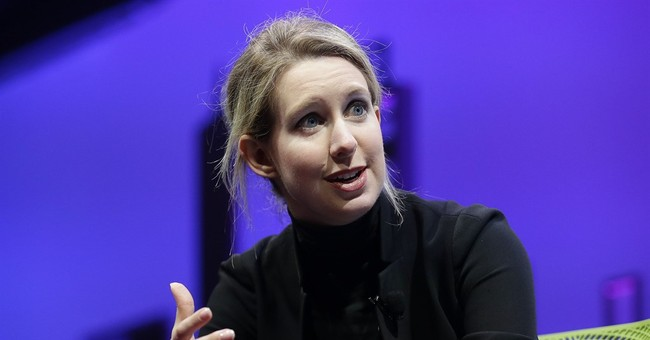 Theranos closing labs, laying off 340 following sanctions