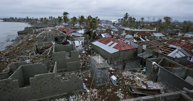 Haiti death toll jumps as receding waters reveal more bodies