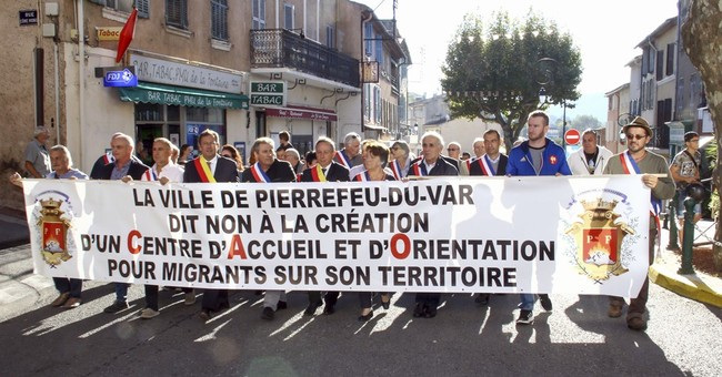 French towns protest plan to take in migrants from Calais