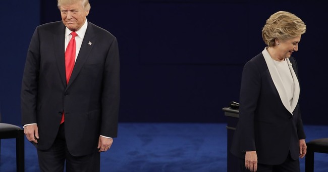 No opening handshake as Clinton, Trump attack on character