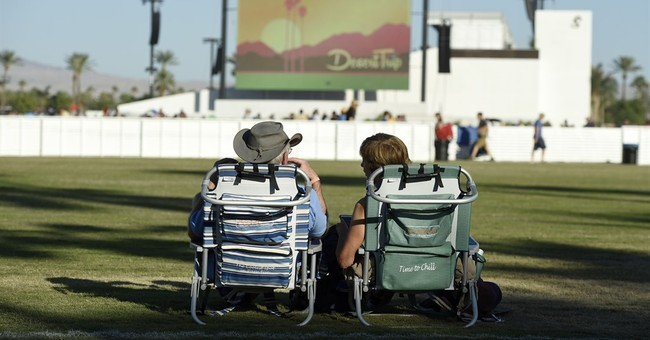 The Latest: Neil Young rocks for 2 hours at Desert Trip
