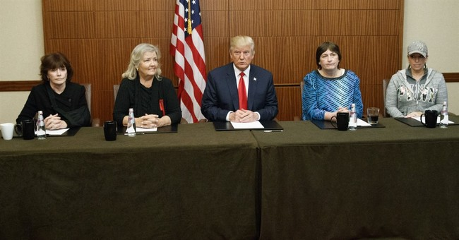Trump, before debate, appears with Bill Clinton's accusers