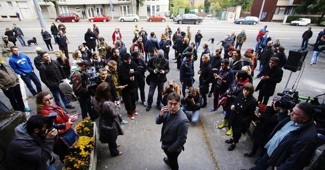 EU to follow Hungary media closely following paper's closure
