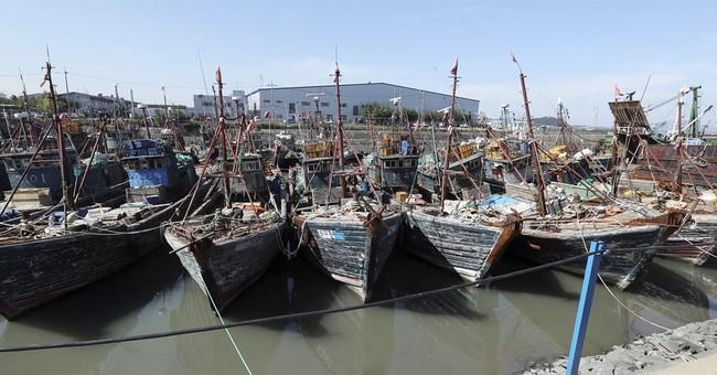 Seoul summons Chinese envoy over sinking of coast guard ship