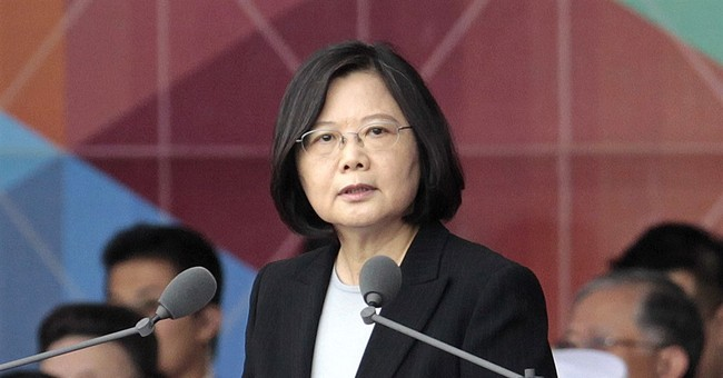 Taiwan president says won't bow to Beijing, calls for talks