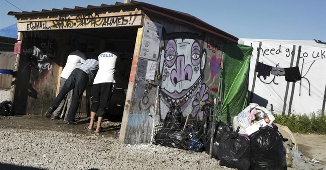 Aid groups say dismantling French refugee camp won't work