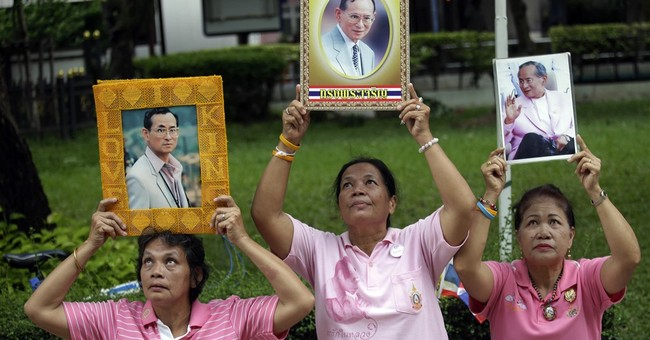 Image of Asia: Praying for the health of Thailand's king