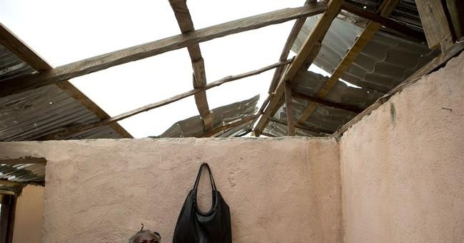 Haitians await aid, help each other regain some normalcy