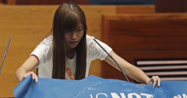 Pro-democracy Hong Kong lawmakers defy China in oath taking