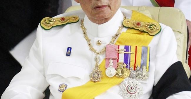Thai stocks tumble, prince rushes home amid king worries