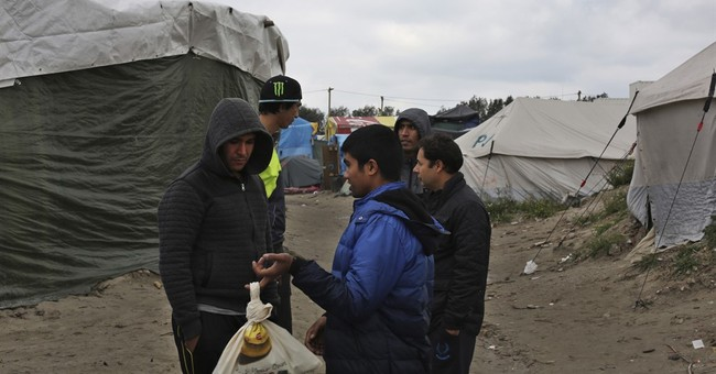 The Latest: 14 migrants detained at Serbian border