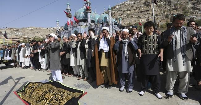 Bomb targeting Shiite worshippers in Afghanistan kills 14