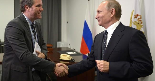 Putin says militants in Aleppo use civilians as shields