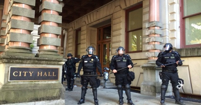 The Latest: Portland police arrest 10 in clash over contract