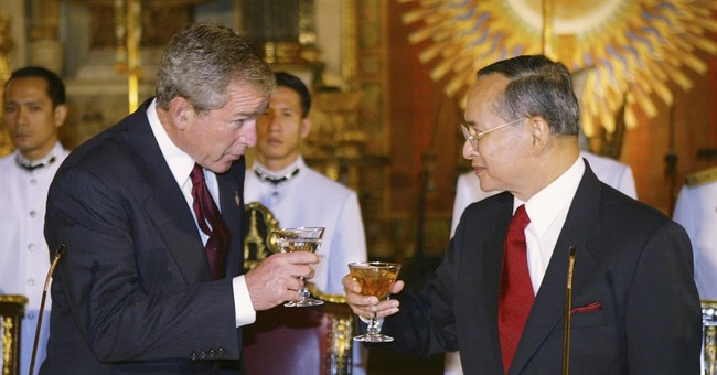 Reign of Thai king saw great change, dozens of governments