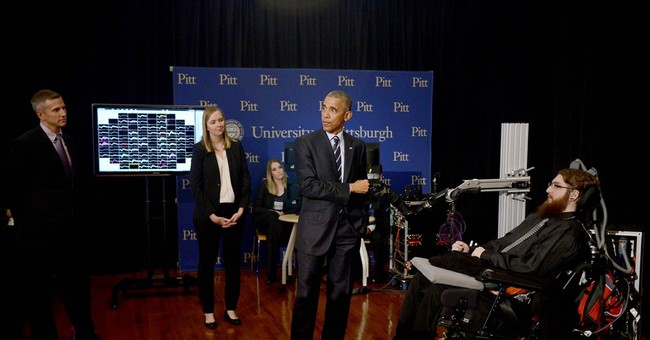 Obama shakes mind-controlled robot hand wired to sense touch