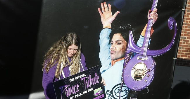 The Latest: Wonder, Khan wow crowd at Prince tribute show