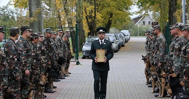 Lithuanian police dog killed in action gets official burial