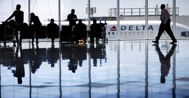Delta posts a profit despite lower airfare, rising expenses