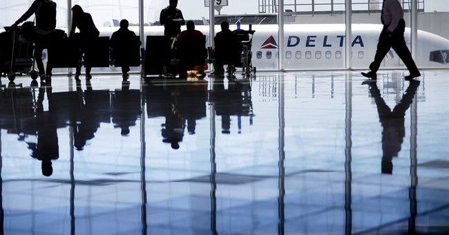 Delta posts a profit despite lower airfare, rising expenses