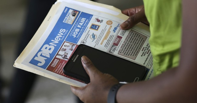 Applications for US unemployment aid remain at 43-year low