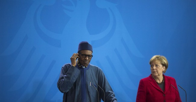 Nigeria's president says wife 'belongs to my kitchen'